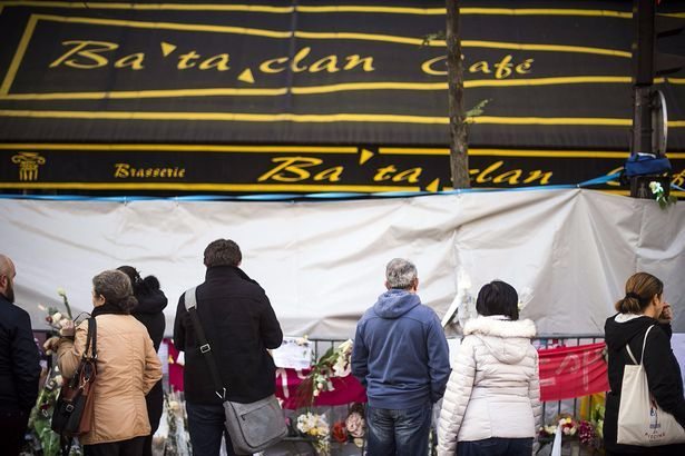 people-stand-in-front-of-the-bataclan-theatre.jpg
