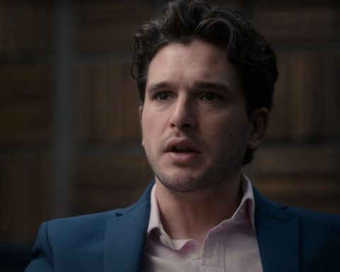 Kit Harrington as Alex in Criminal UK, dressed in a blue suit tearing up.