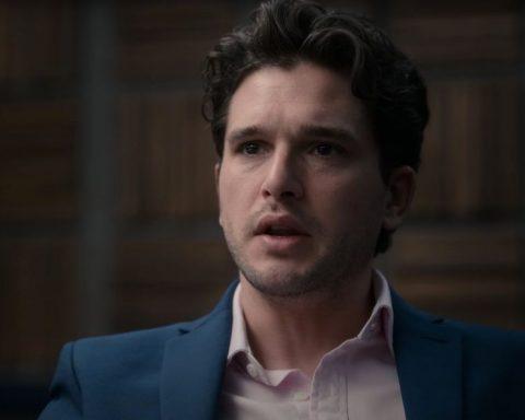 Kit Harrington as Alex in Criminal UK, dressed in a blue suit tearing up.