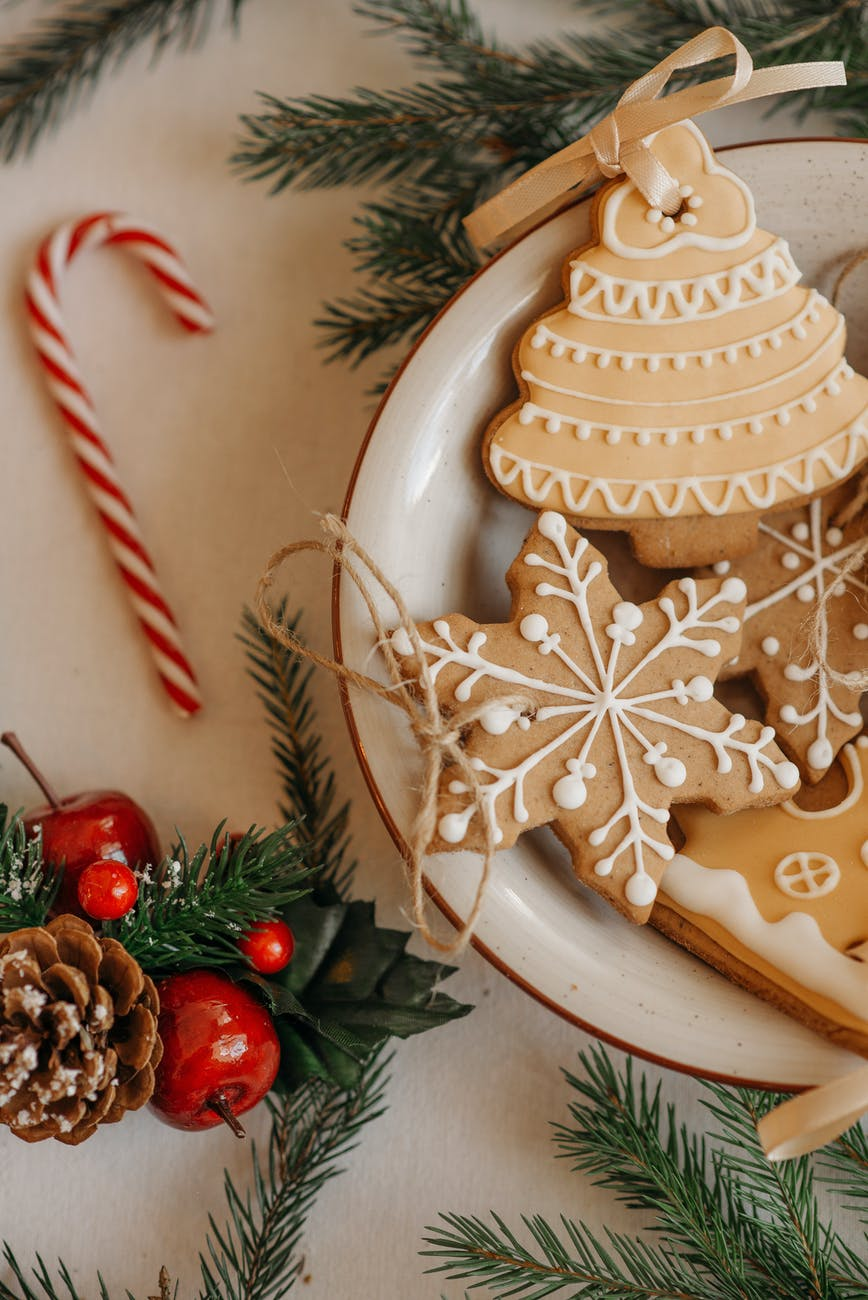 christmas cookies on white ceramic bowl