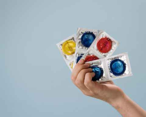 a person holding contraceptives